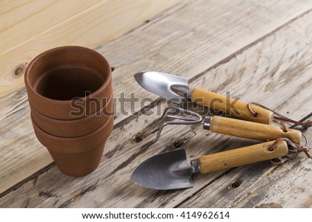 Gardening tools with pots - stock photo