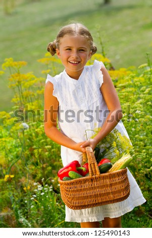Gardening, vegetables - lovely girl with the basket of ecological harvests