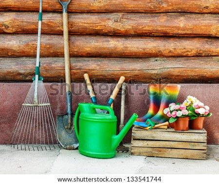 Garderi tools photo against wooden wall - stock photo