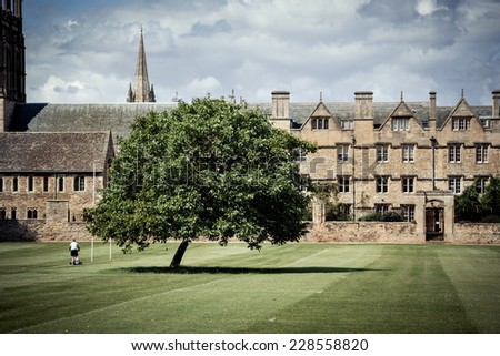 Gardner mowing grounds of Christ Church college , Oxford, UK. - stock photo
