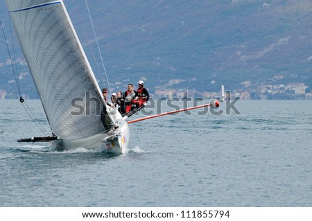 GARGNANO (BS) ITALY - SEPTEMBER 2: Stravaganza sailing boat, skipper Carlo Fracassoli, cuts the finish line and wins the Trofeo Gorla regatta, on September 2, 2012 in Gargnano (BS)