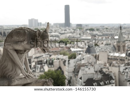 Gargoyle at Notre-Dame Cathedral, Paris - stock photo