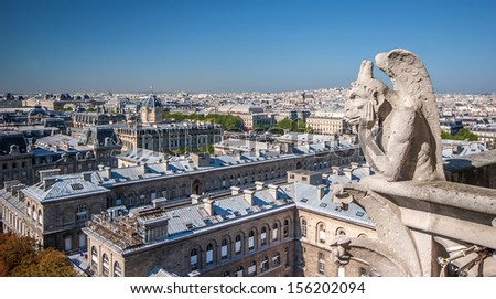 Gargoyle at the top of Notre Dame Cathedral, Paris - stock photo