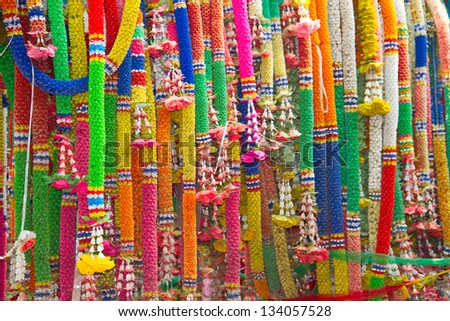 Garland of flowers at the shrine in thailand - stock photo