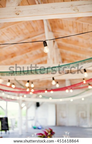 garland of light bulbs and blue and red fringe trim - stock photo