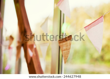 garland of pink and brown flags - stock photo