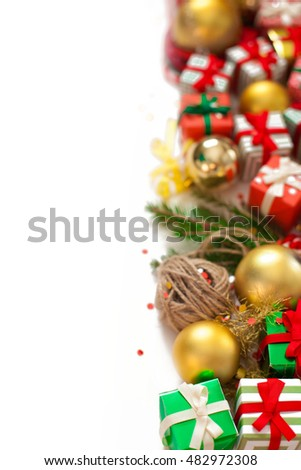 Garland of presents, fir branches and balls. White background. Small handmade gifts in red, green and gold paper.