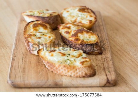 Garlic and cheese bread slices - stock photo