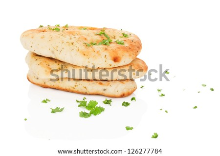Garlic and coriander naan bread with fresh herbs and garlic isolated on white background. Culinary eastern cuisine. - stock photo