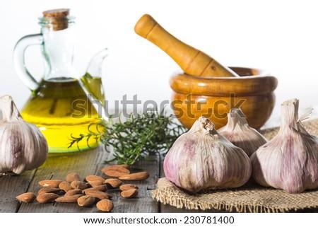 Garlic and mortar for performing garlic mayonnaise - stock photo