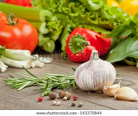 garlic and spice on vegetables background