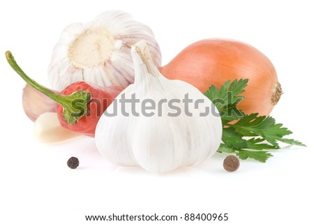 garlic and vegetables with food spices isolated on white background - stock photo