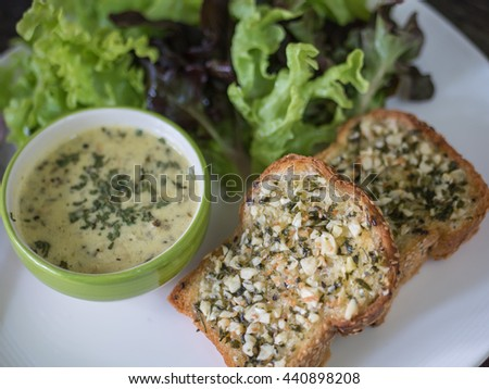 Garlic bread with cream sauce and vegetable - stock photo