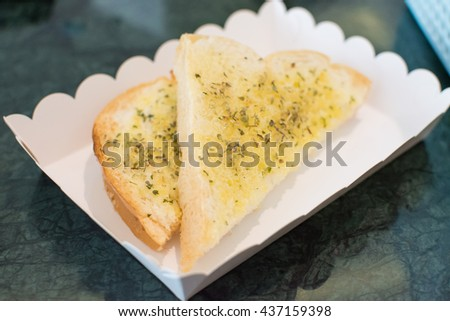 Garlic bread with origano herbs  - stock photo