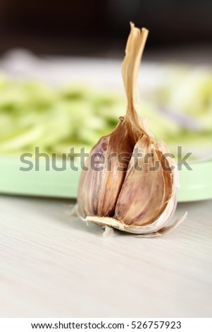 Garlic bulb at background sliced leek. Making Chicken, Cheese and Leek Parcel Series.