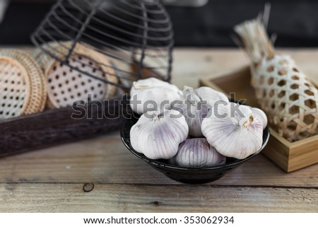garlic bulbs on vintage wooden background