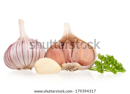 Garlic bulbs with fresh parsley on white background cutout