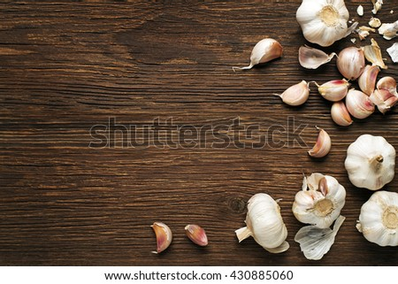 Garlic cloves on a vintage wooden background. - stock photo