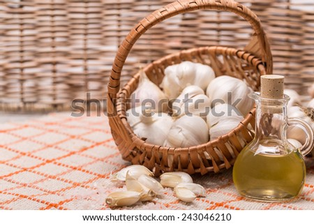 Garlic composition, garlic in wicker basket - stock photo