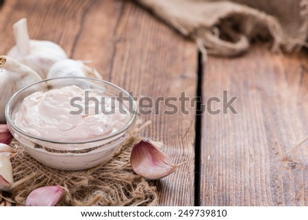 Garlic Dip (Aioli) with ingredients on wooden background - stock photo