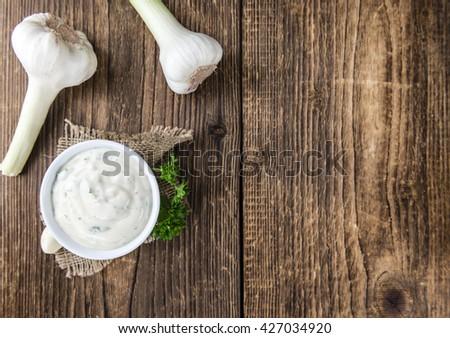 Garlic Dip (selective focus; homemade) on a vintage wooden table - stock photo