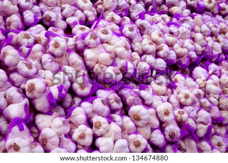 Garlic for sale on the market in Chinchon, Madrid, Spain - stock photo