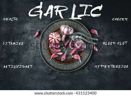 Garlic. Fresh garlic. Red garlic. Garlic press. Violet garlic.Garlic background. garlic bulbs. Medical health concept. Englsh text.  - stock photo