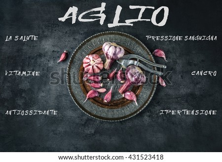Garlic. Fresh garlic. Red garlic. Garlic press. Violet garlic.Garlic background. garlic bulbs. Medical health concept. Italian text.  - stock photo