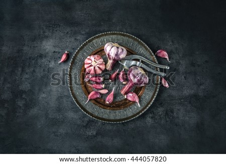 Garlic. Fresh garlic. Red garlic. Garlic press. Violet garlic.Garlic background. garlic bulbs. Medical health concept. - stock photo