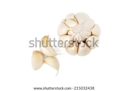 Garlic head and cloves on white background with path