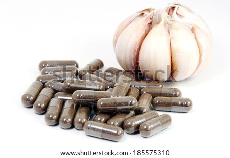 Garlic herbal capsules,oral medicine,alternative medicine isolated on white background. - stock photo