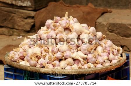 Garlic in a wicker basket on the market in Kathmandu, Nepal.  - stock photo