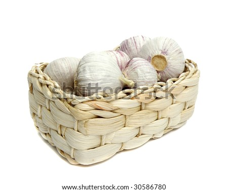 garlic in basket isolated on white