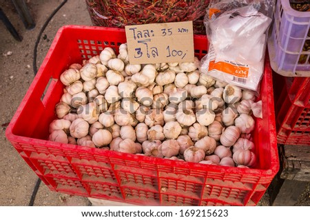 garlic in red plastic box selling in the street market