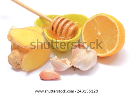 Garlic, lemon, ginger and honey, fresh and healthy food products, concept for healthy nutrition - stock photo
