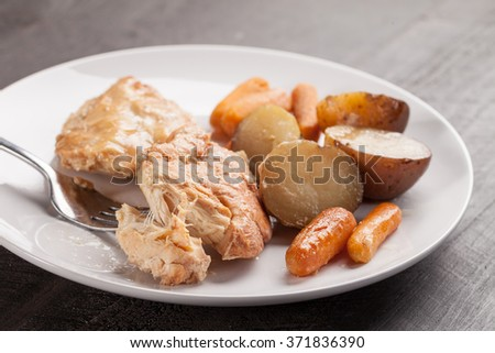 Garlic maple chicken with potatoes and carrots horizontal shot