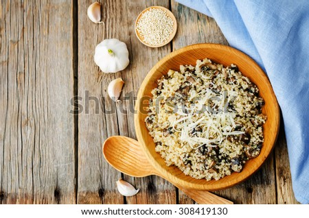 garlic mushroom quinoa on a dark wood background. the toning. selective focus - stock photo