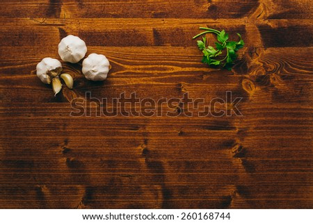 Garlic on a wooden board - stock photo