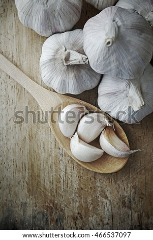 Garlic on a wooden rustic style vintage.