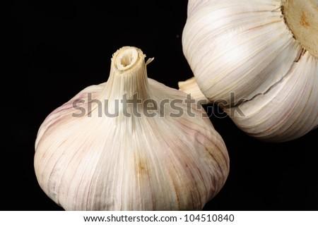 Garlic on black - stock photo