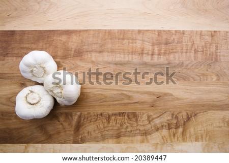 Garlic on Cutting Board - stock photo