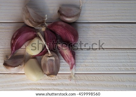 Garlic on white table
