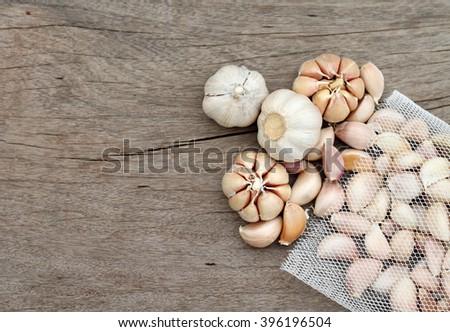 Garlic on wood background - stock photo