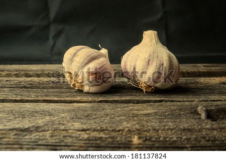 garlic on wooden table. filtered look