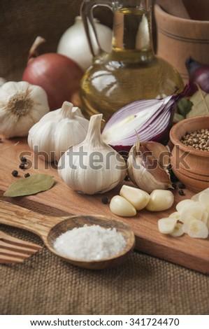 Garlic, onion, coriander, sesame seeds, black pepper, bay leaf,sea salt - stock photo
