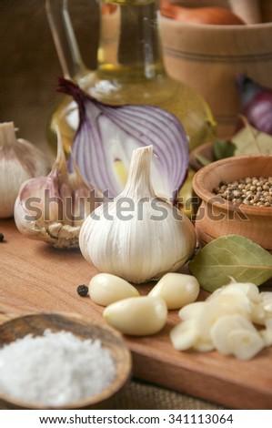 Garlic, onion, coriander, sesame seeds, black pepper, bay leaf, sea salt, olive oil, - stock photo