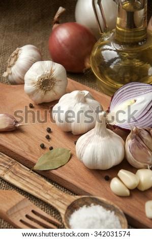 Garlic, onion, coriander, sesame seeds, black pepper, bay leaf, sea salt, olive oil , - stock photo