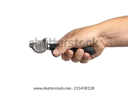 garlic press in hand on a white background - stock photo
