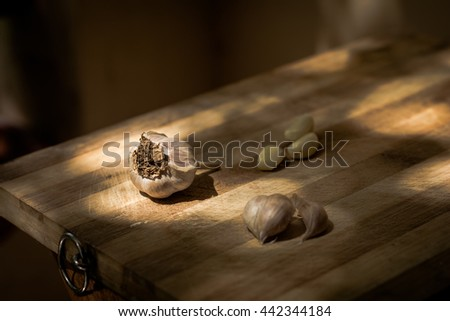 Garlic separated on a wooden board shot outdoors