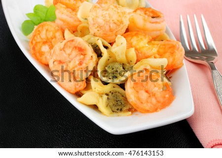 Garlic shrimp on a bed of pesto stuffed pasta, family meal than can be ready in less than thirty minutes